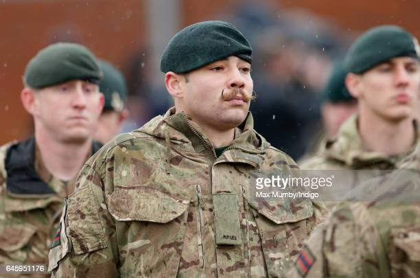 A moustachioed soldier of 4th Battalion The Rifles takes part in a homecoming parade of Riflemen who have recently returned from deployment to Iraq...