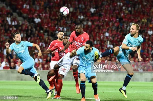 Moustapha Diallo of Nimes and Florian Thauvin and Adil Rami and Valere Germain of Marseille during the French Ligue 1 match between Nimes and...