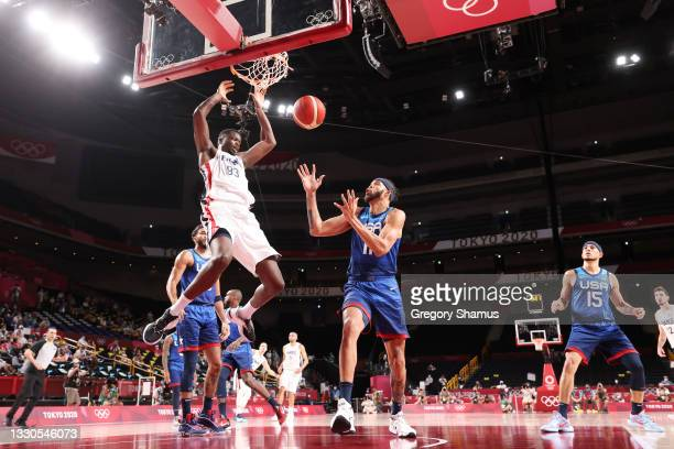 Moustapha Fall of Team France dunks the ball over JaVale McGee of Team United States during the second half of the Men's Preliminary Round Group B...