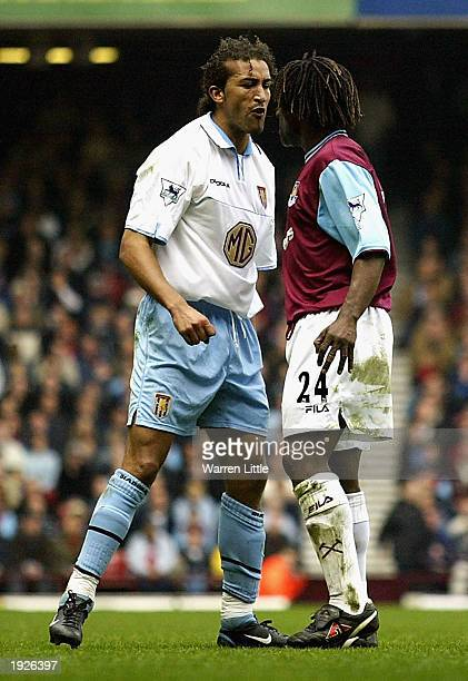 Moustapha Hadji of Aston Villa squares up to Rufus Brevett of West Ham after a tackle during the FA Barclaycard Premiership match between West Ham...