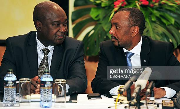 Moustapha Saboune and Abel Belenguele former Seleka militia members from the Central African Republic confer at a press conference in Nairobi on...