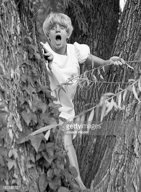 Mouth open and eyes wide American dancer and dance instructor and future actress Goldie Hawn steps between a pair of trees Washington DC September 8...