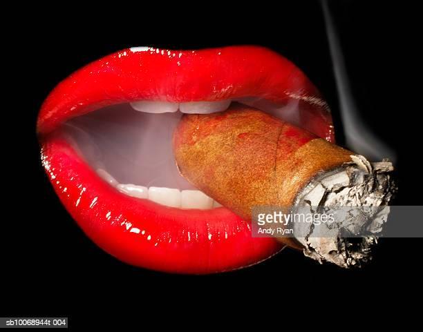 Mouth smoking cigar, close-up, studio shot