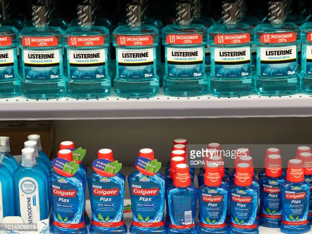 Mouthwashes Listerine and Colgate seen displayed in a supermarket store.