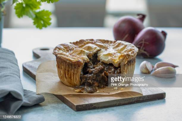 mouthwatering beef or meat pie, opened, with onions, garlic, make you hungry - tradition stock pictures, royalty-free photos & images
