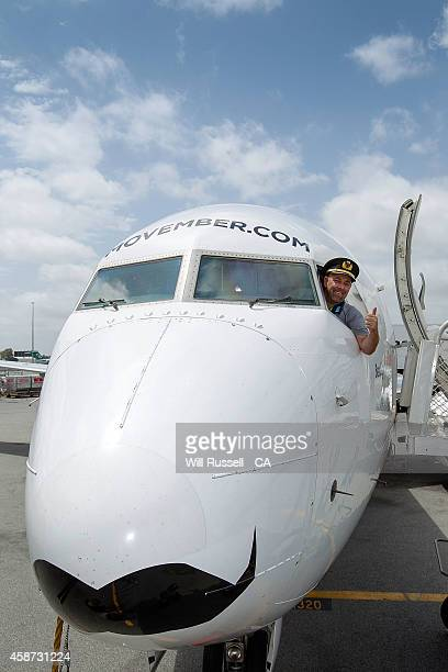 Movember Mo Bros Darren Lehmann poses with the Qantas Mo Plane at Perth Airport on November 10 2014 in Perth Australia