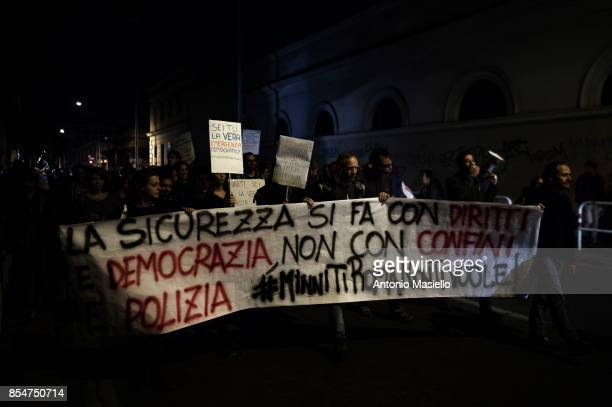 Movement activists protest against the visit of Italian Interior Minister Marco Minniti during the festival dell'Unità in Rome Italy on September 27...