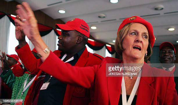 Movement for Democratic Change Secretary for Welfare Kerry Kay dances on May 17 2013 at the official opening of the three day MDC Policy Conference...