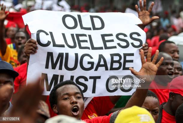 Movement for Democratic Change youth supporters hold up a sign during a demonstration by the opposition party in Harare on April 14 2016 / AFP PHOTO...