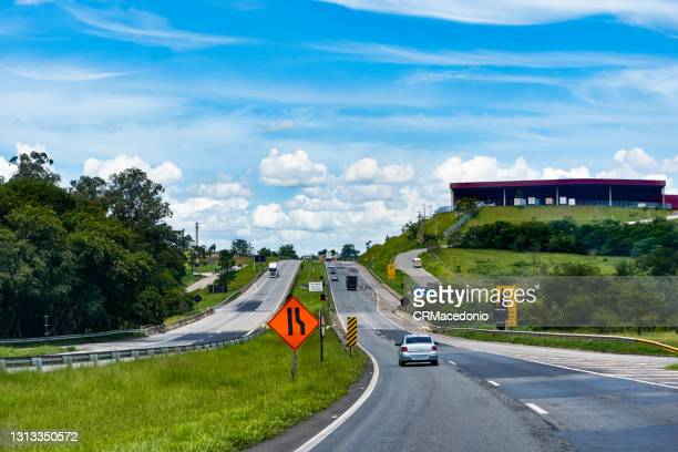 movement of cars and trucks on highway carvalho pinto. - crmacedonio stock pictures, royalty-free photos & images