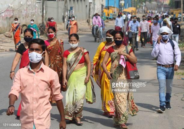 Movement of factory workers seen at Delhi-Gurugram border during a nationwide lockdown due to coronavirus pandemic, at Dundahera Kapashera Border,...