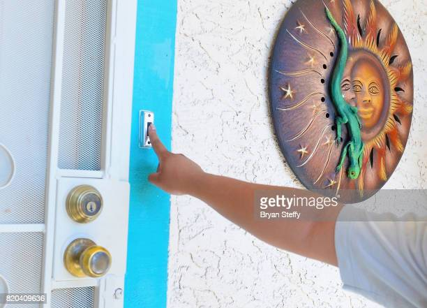 MoveOnorg Civic Action volunteer Adriana Martin of Nevada rings a doorbell as part of the group's Neighborhood Listening Project on July 21 2017 in...