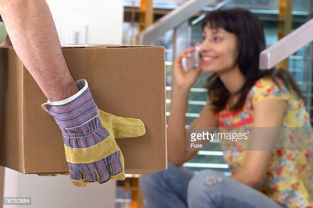 Mover and Woman on Cell Phone