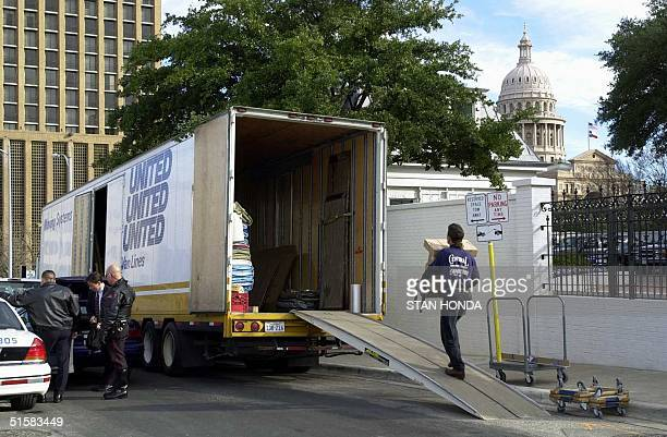 A mover loads boxes of items belonging to US Presidentelect George W Bush and his wife Laura into a truck 08 January 2001 at the Governor's Mansion...