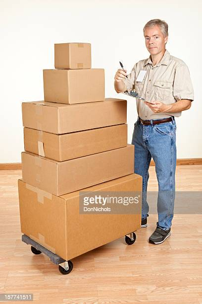 Mover With a Stack of Boxes