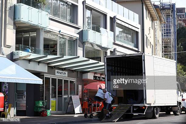 Movers bring in items for former NRL Player Andrew Johns as he moves into his recently purchase property in Bronte on May 19 2016 in Sydney Australia