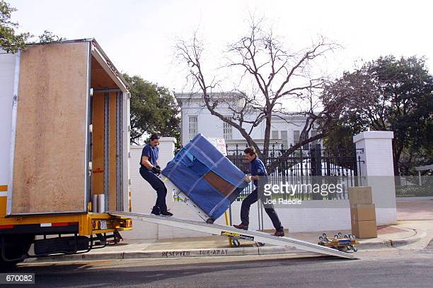 Movers from Central United Van Lines load a truck with the belongings of Presidentelect George W Bush and his family January 8 2001 outside the...