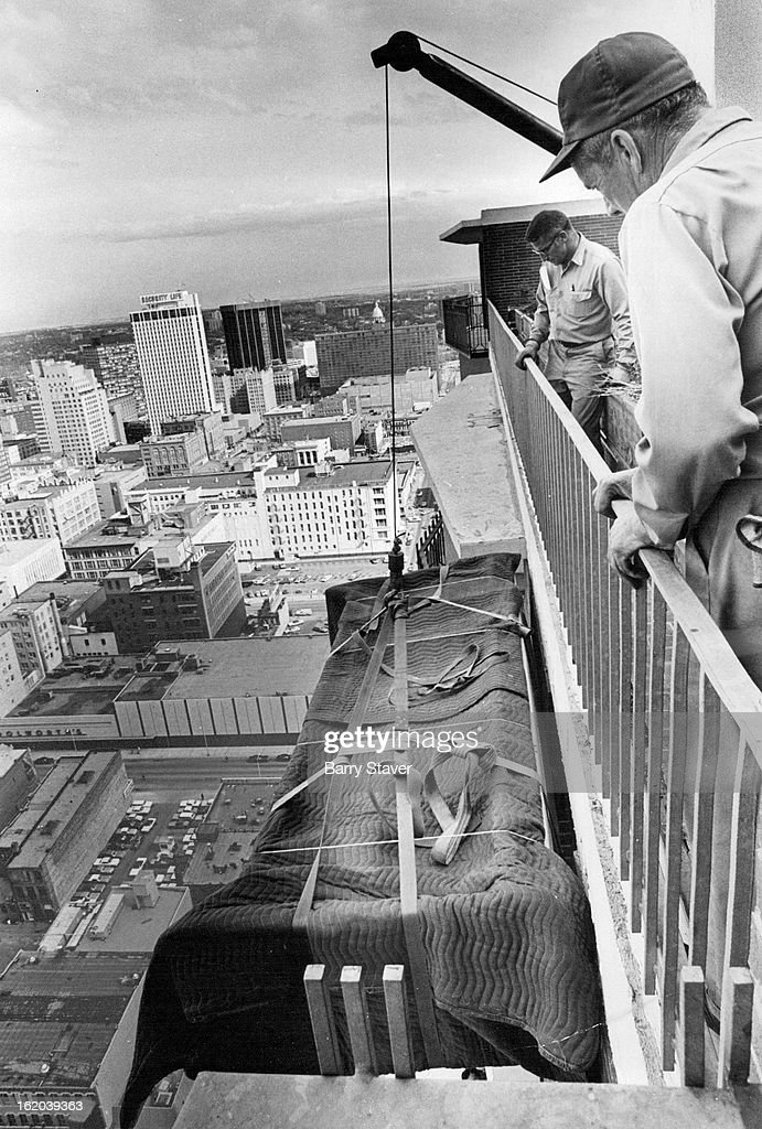 APR 28 1971, APR 30 1971; 42-STORY LIFT ON BRINK OF COMPLETION AT BROOKS TOWERS; Movers from Weicker : News Photo