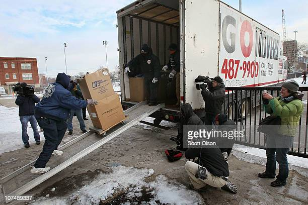 Movers load the possessions of Annie Ricks and her family into a moving truck after she was forced to leave the CabriniGreen public housing complex...
