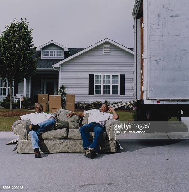 Movers Sitting on Sofa