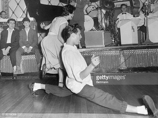 Moves are underway in Britain to ban the American film Rock Around the Clock which reportedly is infecting so many British teenagers and Teddyboys...
