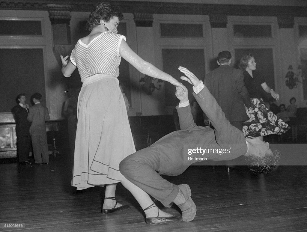 Teenage Couple Dancing to Rock' n Roll : News Photo