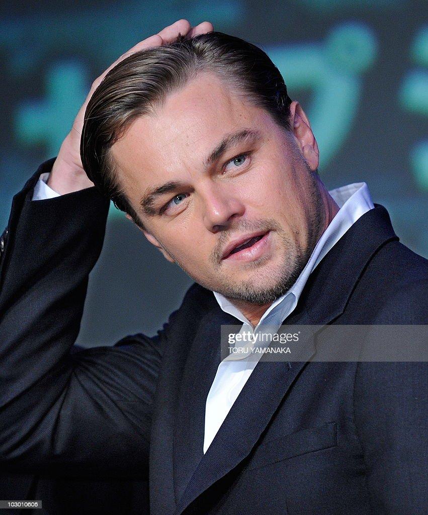 us movie actor leonardo dicaprio adjusts pictures | getty images