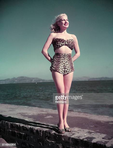 Movie actress Chili Williams, the Polka-Dot Girl, models a leopard skin bathing suit. Portland designer Ed Hamilton introduced fur bathing suits for...
