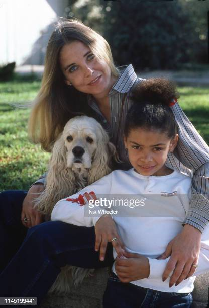 """Movie actress Sue Lyon, star of movie """"Lolita"""" at home with her daughter Nona Harrison in Los Angeles, California, circa 1984:"""