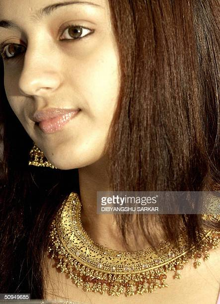 Movie actress Trisha displays a new range of Jewellery named as Tanishq Lightwaight Colors of the Tanishq brand during a press conference in Madras...