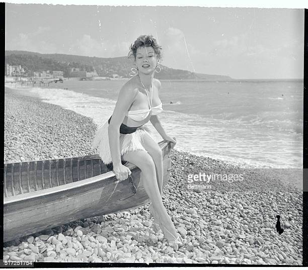 Movie audiences shouldn't mind seeing more of Monique Van Vooren rising young star Monique relaxing on a Nice beach between scenes has been on...