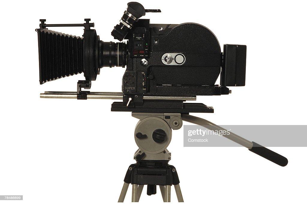 Movie camera on tripod : Stock Photo