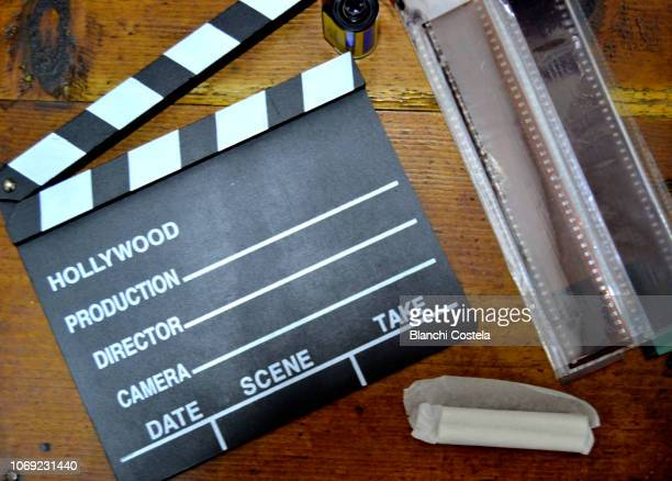 Movie clapper and film roll