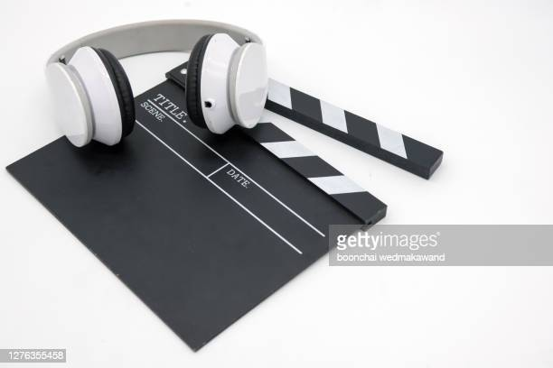 movie clapper board with headphones - storyboard stock pictures, royalty-free photos & images
