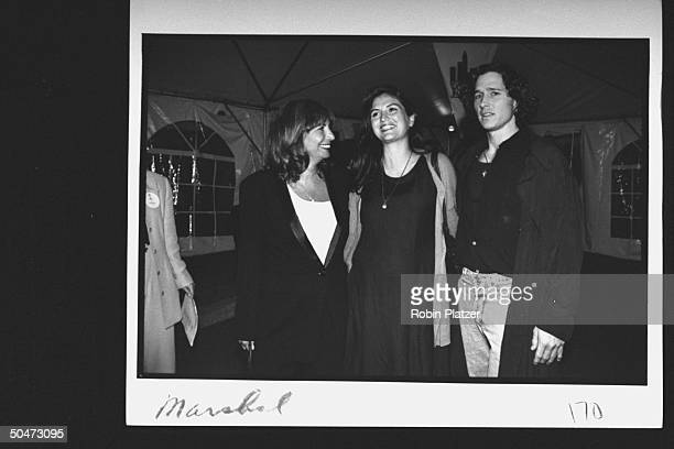 Movie dir/actress Penny Marshall chatting w her pregnant daughter Tracy Reiner her livein Dan Harvey at premiere party for the movie A League of...