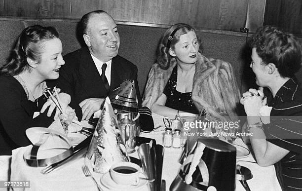 Movie director Alfred Hitchcock is joined by his daughter Patricia MrsLeonard Lyons wife of the newspaper columnist and Hitchcock's wife Alma as they...
