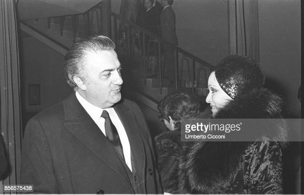 Movie director Federico Fellini with the actress Lucia Bosè during the premiere of 'Victor' at the Quirino theater in Rome in 1969