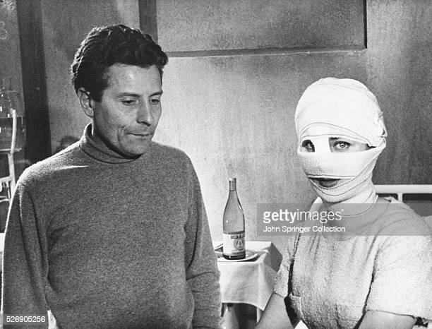 Movie director Georges Franju stands beside actress Juliette Mayniel who plays the role of Edna in his 1960 horror film Les Yeux sans Visage