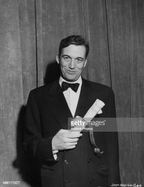 Movie director John Huston posing with his New York Film Critics Award for Best Director awarded for the movie 'The Treasure of the Sierra Madre' 1948
