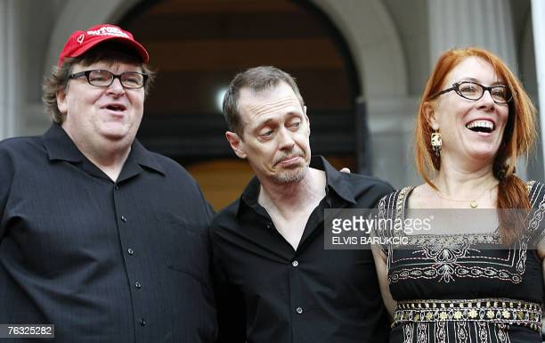 US movie director Michael Moore accompanied by actor director Steve Buschemi and Jo Anderson stand in the red carpet area at the 13th Sarajevo Film...