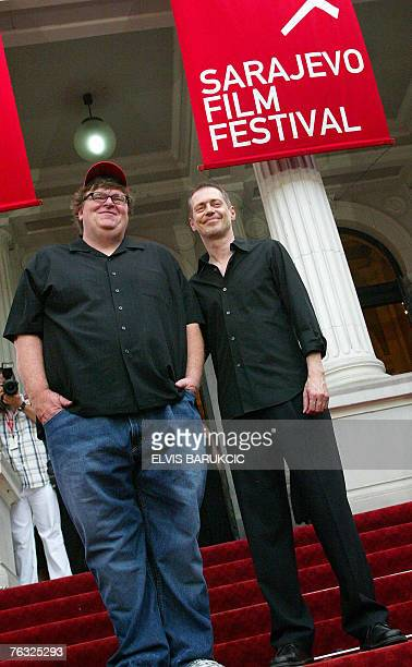 US movie director Michael Moore accompanied by actor director Steve Buschemi stand in the red carpet area at the 13th Sarajevo Film Festival on it's...