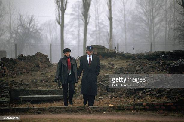 Movie Director/Producer Steven Spielberg and his wife walk through the AuschwitzBirkenau concentration camp on a gloomy rainy day Spielberg was in...