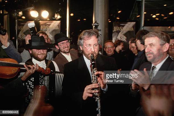 Movie Director/Producer Steven Spielberg plays along with a klezmer band at the opening of the Polish version of his movie Schindler's List which...