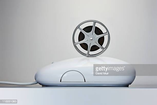 movie film reel on a computer mouse