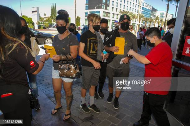 Movie goers enter the theater at screening of Shang-Chi and the Legend of the Ten Rings at AMC theater on Saturday, Sept. 4, 2021 in Monterey Park,...