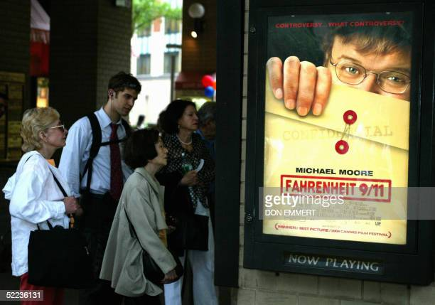 Movie goers line up to see director Michael Moore's documentary Fahrenheit 9/11 at a theater in New York 25 June 2004 Two of the most talkedabout...