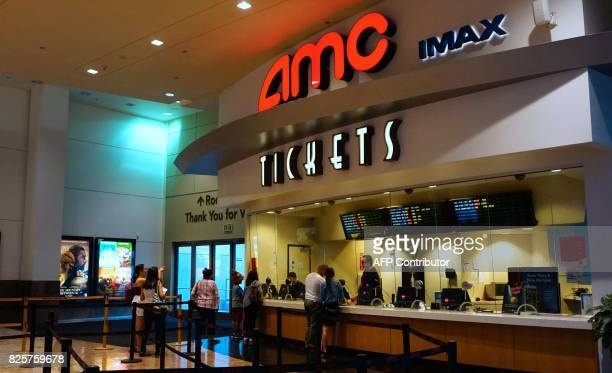 Movie goers purchase automated tickets at an AMC movie theater in Arcadia California on August 2 2017 AMC Entertainment Holdings the world's largest...