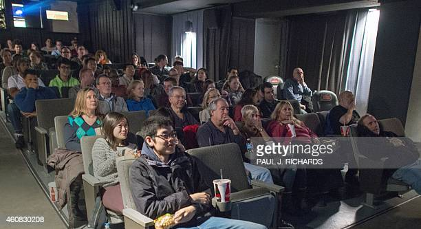 Movie goers watch coming attractions moments before 'The Interview' at West End Cinema on December 25 in Washington DC Raunchy comedy 'The Interview'...