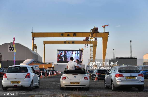 Movie goers watch Grease on the big screen in the Titanic Quarter beneath the famous Harland and Wolff cranes on June 13, 2020 in Belfast, Northern...
