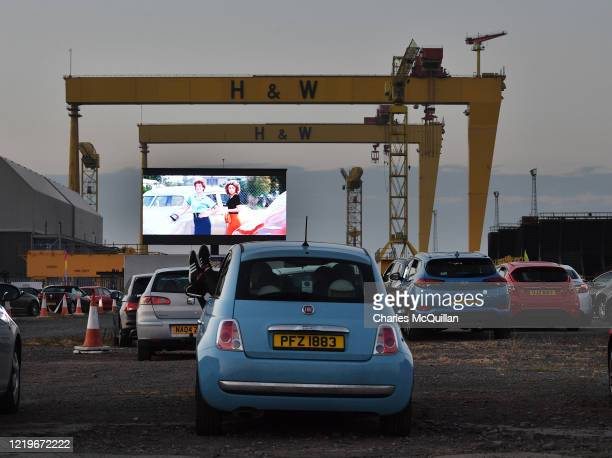 Movie goers watch Grease on the big screen in the Titanic Quarter beneath the famous Harland and Wolff cranes on June 13 2020 in Belfast Northern...